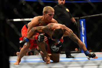 July 11, 2012; San Jose, CA, USA; T.J. Dillashaw (top) fights Vaughan Lee (bottom) during the bantamweight bout of the UFC on Fuel TV at HP Pavilion. Mandatory Credit: Kyle Terada-US PRESSWIRE