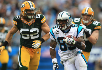Clay Matthews, A.J. Hawk chase down Panthers wide receiver Steve Smith.
