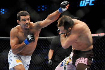 DALLAS - SEPTEMBER 19:  UFC fighter Vitor Belfort  (L) battles UFC fighter Rich Franklin (R) during their Catch weight bout at UFC 103: Franklin vs. Belfort at the American Airlines Center on September 19, 2009 in Dallas, Texas.  (Photo by Jon Kopaloff/Ge