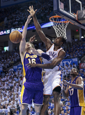 Serge blocks Spanish teammate Pau Gasol in an NBA game.