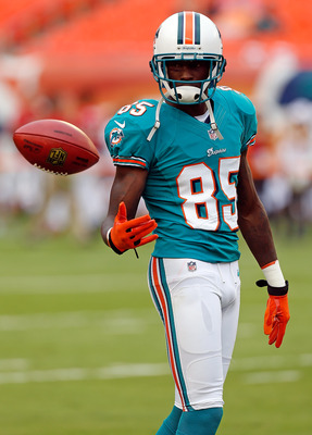 MIAMI GARDENS, FL - AUGUST 10:  Receiver Chad Johnson #85 of the Miami Dolphins warms up just before the start of the NFL Preseason Game against the Tampa Bay Buccaneers at Sun Life Stadium on August 10, 2012 in Miami Gardens, Florida.  (Photo by J. Meric