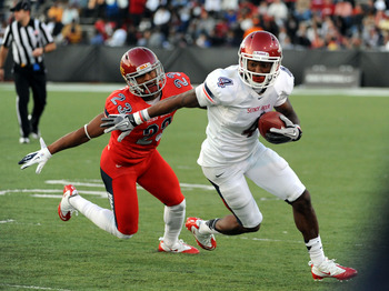 January 28, 2012; Mobile, AL, USA; South Squad wide receiver Joe Adams (4) of Arkansas runs after a catch and is defended by North Squad defensive back Leonard Johnson (23) of Iowa State during the Senior Bowl at Ladd-Peebles Stadium. Mandatory Credit: Ch