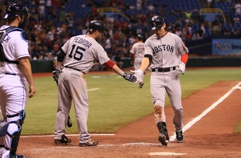 Pedroia greeting Ellsbury at the plate: something Sox fans long to see.