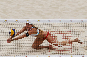 BEIJING, CHINA - MAY 09:  April Ross (R) of the United States in action during the 2012 Swatch FIVB World Tour Beijing Grand Slam pool E match with Jennifer Kessy against Katrin Holtwick and Ilka Semmler of Germany in Chaoyang Park on May 9, 2012 in Beiji