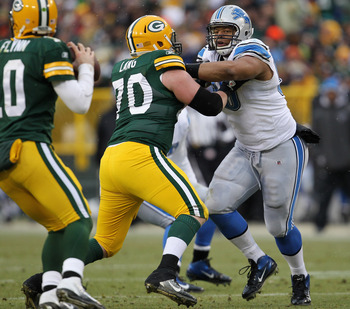 GREEN BAY, WI - JANUARY 01:  Ndamukong Suh #90 of the Detroit Lions rushes against T.J. Lang #70 of the Green Bay Packers at Lambeau Field on January 1, 2012 in Green Bay, Wisconsin. The Packers defeated the Lions 45-41.  (Photo by Jonathan Daniel/Getty I