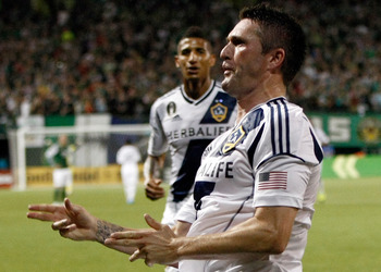 Robbie Keane celebrates in trademark fashion.