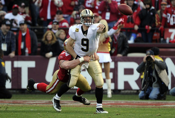 Brees throws a pass left-handed. Whatever it takes to win.