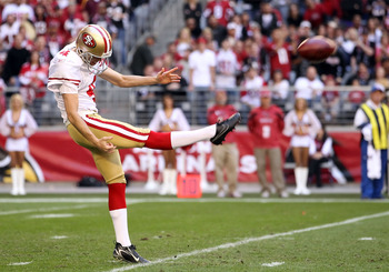 GLENDALE, AZ - DECEMBER 11:  Punter Andy Lee #4 of the San Francisco 49ers kicks the football during the NFL game against the Arizona Cardinals at the University of Phoenix Stadium on December 11, 2011 in Glendale, Arizona.  The Cardinals defeated the 49e