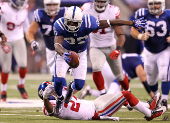 INDIANAPOLIS - SEPTEMBER 19:  Reggie Wayne #87 of the Indianapolis Colts runs with the ball during the NFL game against the New York Giants  at Lucas Oil Stadium on September 19, 2010 in Indianapolis, Indiana.  (Photo by Andy Lyons/Getty Images)