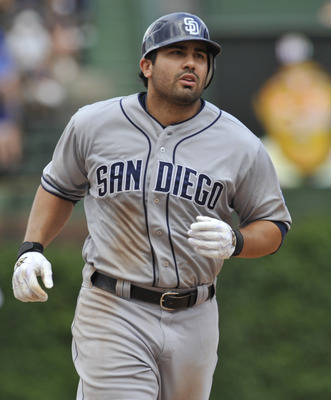 CHICAGO, IL - MAY 29: Carlos Quentin #18 of the San Diego Padres hits a solo home run in the fifth inning against the Chicago Cubs on May 29, 2012 at Wrigley Field in Chicago, Illinois.  (Photo by David Banks/Getty Images)