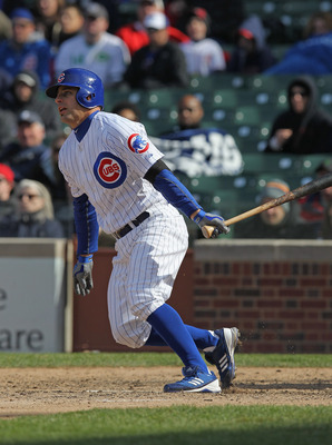 CHICAGO, IL - APRIL 22:  Reed Johnson #5 of the Chicago Cubs bats against the Cincinnati Reds at Wrigley Field on April 22, 2012 in Chicago, Illinois. The Reds defeated the Cubs 4-3.  (Photo by Jonathan Daniel/Getty Images)