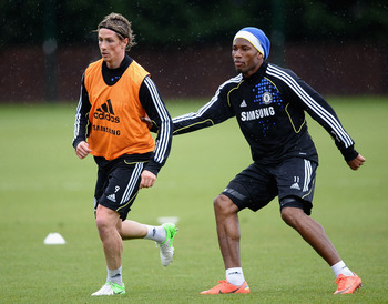 With Didier Drogba (right) now gone, Roberto Di Matteo can start Fernando Torres.