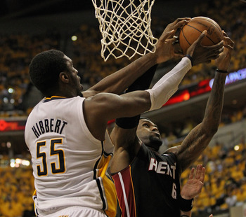 INDIANAPOLIS, IN - MAY 24: LeBron James #6 of the Miami Heat takes a rebound away from Roy Hibbert #55 of the Indiana Pacers in Game Six of the Eastern Conference Semifinals in the 2012 NBA Playoffs at Bankers Life Fieldhouse on May 24, 2012 in Indianapol