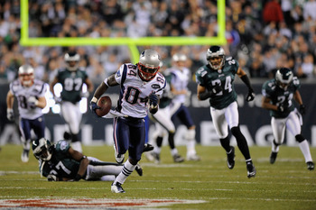 PHILADELPHIA, PA - NOVEMBER 27:  Deion Branch #84 of the New England Patriots catches a 63-yard reception in the second quarter against Brandon Hughes (L) #27 and Nnamdi Asomugha #24 of the Philadelphia Eagles at Lincoln Financial Field on November 27, 20