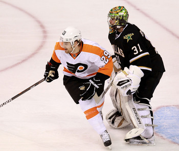 DALLAS, TX - DECEMBER 21:  Harry Zolnierczyk #29 of the Philadelphia Flyers skates past Richard Bachman #31 of the Dallas Stars at American Airlines Center on December 21, 2011 in Dallas, Texas.  (Photo by Ronald Martinez/Getty Images)