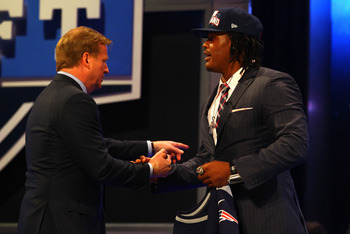 NEW YORK, NY - APRIL 26:  Dont'a Hightower of Alabama greets NFL Commissioner Roger Goodell after he was selected #25 overall by the New England Patriots in the first round of the 2012 NFL Draft at Radio City Music Hall on April 26, 2012 in New York City.