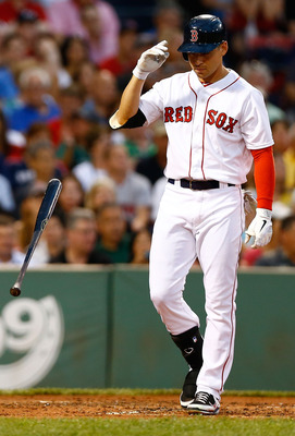 BOSTON, MA - JULY 19:  Jacoby Ellsbury #2 of the Boston Red Sox throws his bat to the ground after striking out against the Chicago White Sox during the game on July 19, 2012 at Fenway Park in Boston, Massachusetts.  (Photo by Jared Wickerham/Getty Images