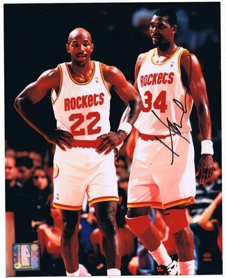 http://rackrs.com/MarketplaceItem/122/hakeem-olajuwon-signed-houston-rockets-photo