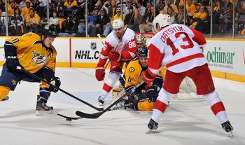 NASHVILLE, TN - APRIL 11: Ryan Suter #20 and Shea Weber #6 of the Nashville Predators defend Tomas Holmstrom #96 and Pavel Datsyuk #13 of the Detroit Red Wings in Game One of the Western Conference Quarterfinals during the 2012 NHL Stanley Cup Playoffs at
