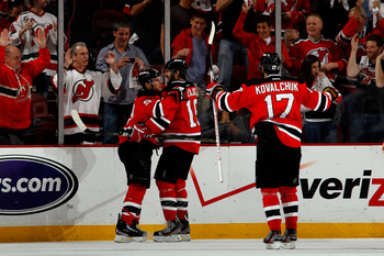 NEWARK, NJ - JUNE 09: Zach Parise #9 of the New Jersey Devils celebrates with teammates Travis Zajac #19 and Ilya Kovalchuk #17 after scoring a goal in the first period against the Los Angeles Kings during Game Five of the 2012 NHL Stanley Cup Final at th