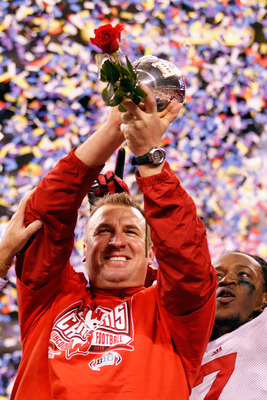 Wisconsin Head Coach Bret Bielema will raise the Big Ten Championship trophy for the third straight year