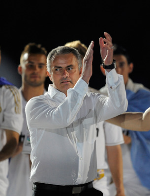 MADRID, SPAIN - MAY 13:  Real Madrid CF head coach Jose Mourinho (C) celebrates the La Liga title after the La Liga match between Real Madrid CF and RCD Mallorca at Estadio Santiago Bernabeu on May 13, 2012 in Madrid, Spain.  (Photo by Denis Doyle/Getty I