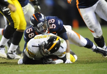 Jan 8 2012; Denver, CO, USA; Pittsburgh Steelers quarterback Ben Roethlisberger (7) is sacked by Denver Broncos outside linebacker Von Miller (58) during the 2011 AFC wild card playoff game at Sports Authority Field. The Broncos defeated the Steelers 23-2