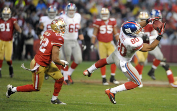 Jan 22, 2012; San Francisco, CA, USA; New York Giants wide receiver Victor Cruz (80) catches a pass against San Francisco 49ers cornerback Carlos Rogers (22) during the first half of the 2011 NFC Championship game at Candlestick Park.  Mandatory Credit: K