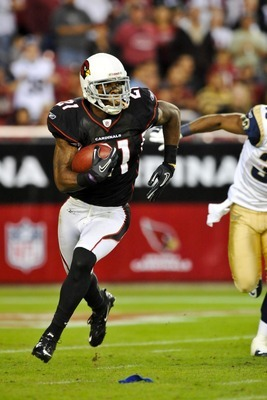 Nov 5, 2011; Glendale, AZ, USA; Arizona Cardinals cornerback Patrick Peterson (21) returns a punt 99 yards for a touchdown in overtime against the St. Louis Rams at University of Phoenix Stadium.  Mandatory Credit: Chris Morrison-US PRESSWIRE