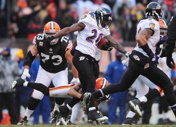 Dec. 26, 2010; Cleveland, OH, USA; Baltimore Ravens safety Ed Reed (20) runs with the ball after intercepting a pass during the fourth quarter against the Cleveland Browns at Browns Stadium. Mandatory Credit: Andrew Weber-US PRESSWIRE