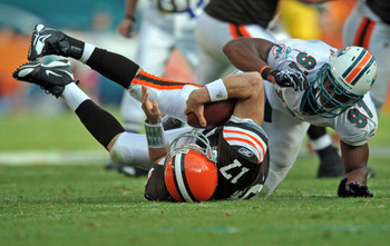 Dec. 5 2010;  Miami, FL, USA; Miami Dolphins linebacker Cameron Wake (91) sacks Cleveland Browns quarterback Jake Delhomme (17) during the second half at Sun Life Stadium. The Browns won 13-10. Mandatory Credit: Steve Mitchell-US PRESSWIRE