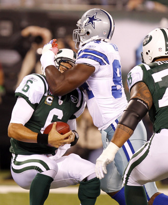 Sep 11, 2011; East Rutherford, NJ, USA; Dallas Cowboys outside linebacker DeMarcus Ware (94) sacks New York Jets quarterback Mark Sanchez (6) during the game at MetLife Stadium. Mandatory Credit: Tim Farrell/THE STAR-LEDGER via US PRESSWIRE