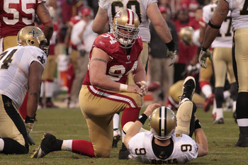 Jan 14, 2012; San Francisco, CA, USA; San Francisco 49ers defensive end Justin Smith (94) looks at New Orleans Saints quarterback Drew Brees (9) during the fourth quarter of the 2011 NFC divisional playoff game at Candlestick Park. The 49ers defeated the