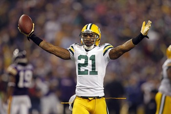 Oct 23, 2011; Minneapolis, MN, USA; Green Bay Packers cornerback Charles Woodson (21) celebrates his interception against the Minnesota Vikings in the third quarter at the Metrodome. The Packers win 33-27. Mandatory Credit: Bruce Kluckhohn-US PRESSWIRE