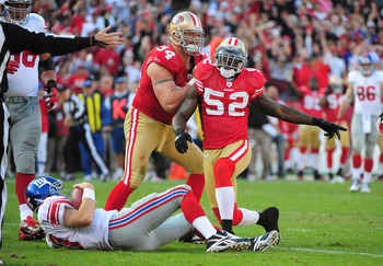 November 13, 2011; San Francisco, CA, USA; San Francisco 49ers inside linebacker Patrick Willis (52) is congratulated by defensive end Justin Smith (94) after sacking New York Giants quarterback Eli Manning (bottom) during the third quarter at Candlestick