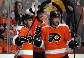 PHILADELPHIA, PA - FEBRUARY 18:  Eric Wellwood #47 (L) of the Philadelphia Flyers scores his first NHL goal against the Pittsburgh Penguins at 18:41 of the second period and is joined by Braydon Coburn #5 (C) and Sean Couturier #14 (R) at the Wells Fargo