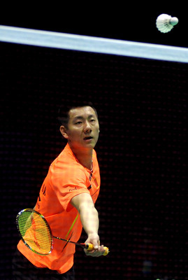 QINGDAO, CHINA - APRIL 22:  Chen Jin of China in action against Du Pengyu of China during their men's singles final match during day six of the 2012 Badminton Asia Championships at Qingdao Guoxin Gymnasium on April 22, 2012 in Qingdao, China.  (Photo by H