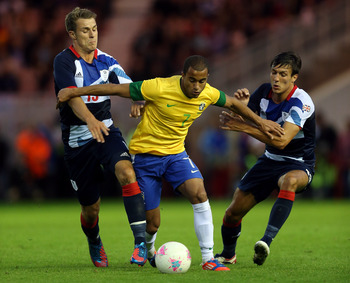 MIDDLESBROUGH, ENGLAND - JULY 20:  Lucas of Brazil holds off Aaron Ramsey and Jack Cork of GB during the international friendly match between Team GB and Brazil at Riverside Stadium on July 20, 2012 in Middlesbrough, England.  (Photo by Julian Finney/Gett