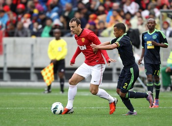 CAPE TOWN, SOUTH AFRICA - JULY 21: Dimitar Berbatov of Manchester United in action during the MTN Football Invitational match between Ajax Cape Town and Manchester United at Cape Town Stadium on July 21, 2012 in Cape Town, South Africa.  (Photo by Luke Wa