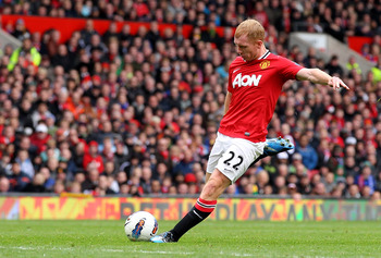 MANCHESTER, ENGLAND - APRIL 08:  Paul Scholes of Manchester United scores his team's second goal  during the Barclays Premier League match between Manchester United and Queens Park Rangers at Old Trafford on April 8, 2012 in Manchester, England. (Photo by