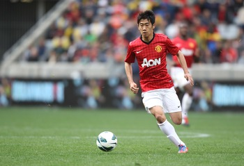 CAPE TOWN, SOUTH AFRICA - JULY 21: Shinji Kagawa of Manchester United FC in action during the MTN Football Invitational match between Ajax Cape Town and Manchester United at Cape Town Stadium on July 21, 2012 in Cape Town, South Africa.  (Photo by Luke Wa