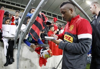 DURBAN, SOUTH AFRICA - JULY 17:  Anderson signs autographs during the Manchester United training session at Moses Mabhida Stadium on July 17, 2012 in Durban, South Africa. (Photo by Anesh Debiky/Gallo Images/Getty Images)