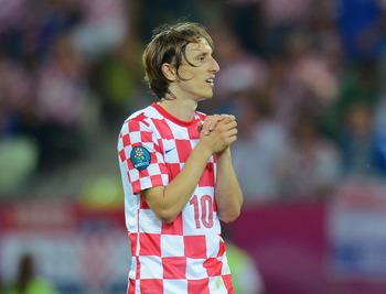 GDANSK, POLAND - JUNE 18:  Luka Modric of Croatia reacts during the UEFA EURO 2012 group C match between Croatia and Spain at The Municipal Stadium on June 18, 2012 in Gdansk, Poland.  (Photo by Shaun Botterill/Getty Images)