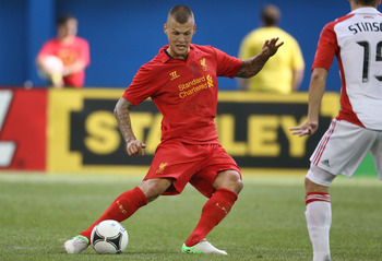 TORONTO, CANADA - JULY 21: Martin Skrtel #37 of Liverpool advances the ball against Toronto FC during the World Football Challenge friendly match on July 21, 2012 at Rogers Centre in Toronto, Ontario, Canada. (Photo by Tom Szczerbowski/Getty Images)