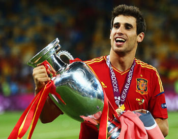 KIEV, UKRAINE - JULY 01:  Javi Martinez of Spain celebrates with the trophy following victory in the UEFA EURO 2012 final match between Spain and Italy at the Olympic Stadium on July 1, 2012 in Kiev, Ukraine.  (Photo by Alex Grimm/Getty Images)