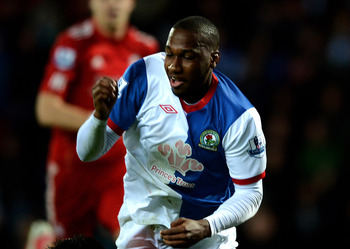 BLACKBURN, ENGLAND - APRIL 10:  Alexander Doni of Liverpool brings down Junior Hoilett of Blackburn Rovers to concede a peanlty during the Barclays Premier League match between Blackburn Rovers and Liverpool at Ewood park on April 10, 2012 in Blackburn, E