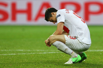 WROCLAW, POLAND - JUNE 16:  Robert Lewandowski of Poland sits dejected at the final whistle during the UEFA EURO 2012 group A match between Czech Republic and Poland at The Municipal Stadium on June 16, 2012 in Wroclaw, Poland.  (Photo by Christof Koepsel