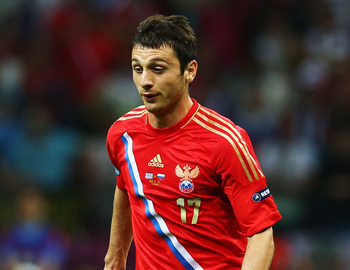 WARSAW, POLAND - JUNE 16:  Alan Dzagoev of Russia runs with the ball during the UEFA EURO 2012 group A match between Greece and Russia at The National Stadium on June 16, 2012 in Warsaw, Poland.  (Photo by Shaun Botterill/Getty Images)
