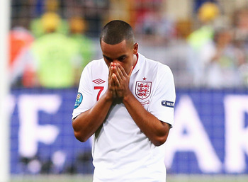 KIEV, UKRAINE - JUNE 24: Theo Walcott of England looks dejected after defeat during the UEFA EURO 2012 quarter final match between England and Italy at The Olympic Stadium on June 24, 2012 in Kiev, Ukraine.  (Photo by Alex Livesey/Getty Images)