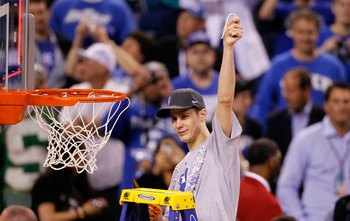 Scheyer cuts down the nets after winning the 2010 NCAA title.